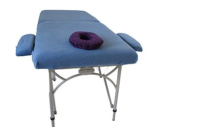 1 Massage table with blue cover, armrest cover, dark purple face cushion