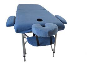 Massage Table With Set of Blue Covers