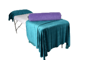 Covered Bolster on massage table with covers